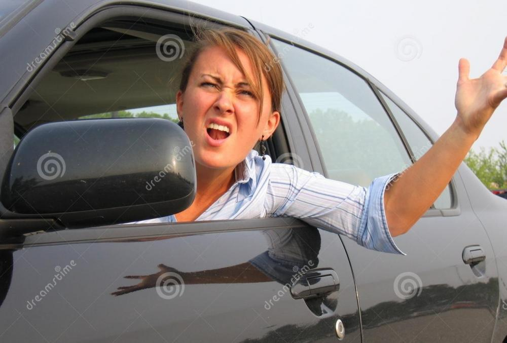 angry-woman-yelling-out-car-window-212012.jpg